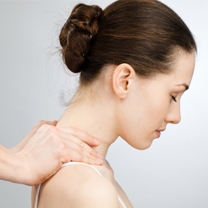 woman having neck adjusted